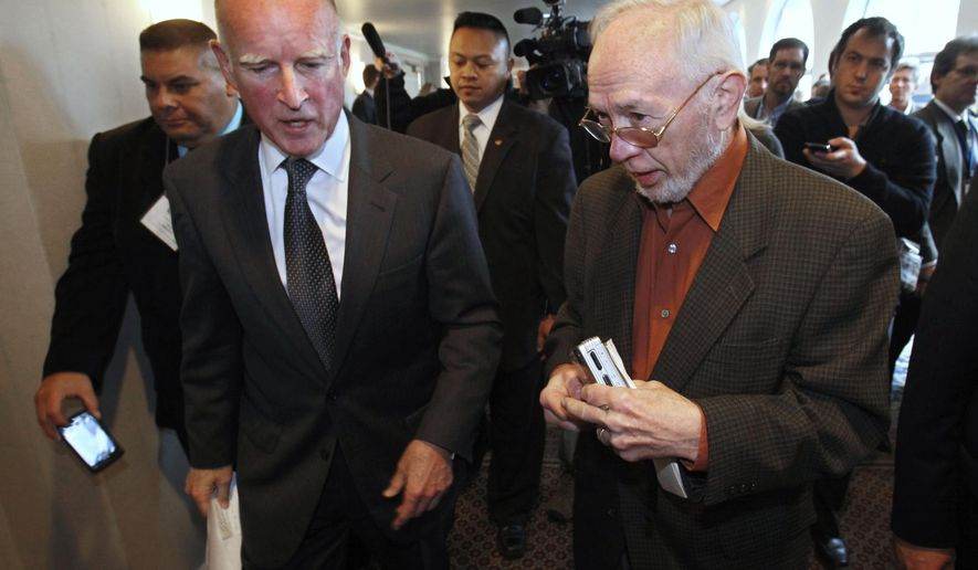 In this Wednesday, Jan. 19, 2011 photo former Associated Press Correspondent Doug Willis, right, talks with Gov. Jerry Brown in Sacramento, Calif. Willis, who covered California politics for the AP for more than three decades, passed away Tuesday, Dec. 15, 2015, from complications following hip surgery. He was 77. (AP Photo/Rich Pedroncelli)