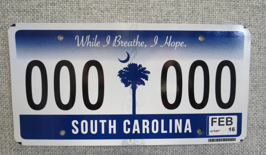 This photo provided by the South Carolina Department of Motor Vehicles on Dec. 15, 2015 shows the new South Carolina license plate and stickers that will be issued to motorists in the state in the coming months. The new plate features one sticker in the lower right corner instead of the two stickers in each corner that are used on the current South Carolina plates. (AP Photo/Courtesy of the South Carolina Department of Motor Vehicles)
