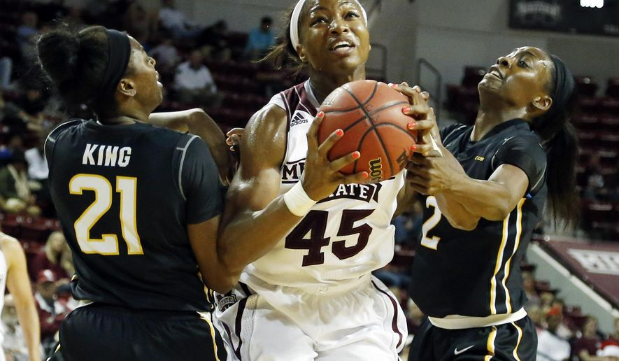 Mississippi State center Chinwe Okorie (45) attempts a layup between Southern Mississippi guard Jayla King (21) and forward Lashyra Cotton (2) in the first half of an NCAA college basketball game in Starkville, Miss., Wednesday, Dec. 16, 2015. (AP Photo/Rogelio V. Solis)
