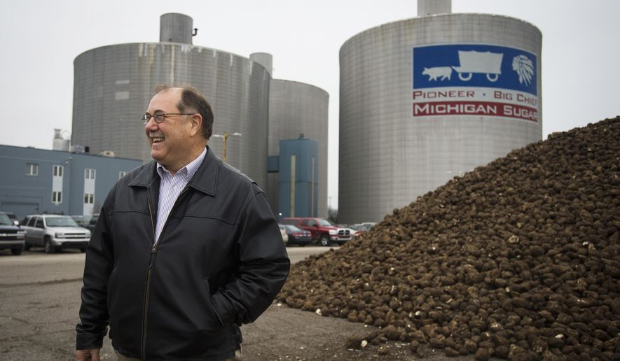 Michigan Sugar. Co. Vice President of Agriculture Paul Pfenninger stands outside the company's processing facility and headquarters in Bay County's Monitor Township, Mich., Wednesday, Dec. 16, 2015. The Bay City-based grower-owned cooperative said Tuesday the total 2015 production was roughly 5 million tons, representing a record crop. (Yfat Yossifor/The Bay City Times via AP) MANDATORY CREDIT