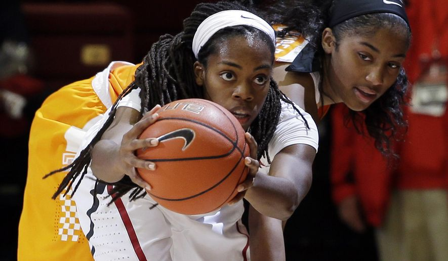 Stanford guard Lili Thompson grabs a rebound next to Tennessee guard Te'a Cooper during the second half of an NCAA college basketball game Wednesday, Dec. 16, 2015, in Stanford, Calif. Stanford won 69-55. (AP Photo/Marcio Jose Sanchez)