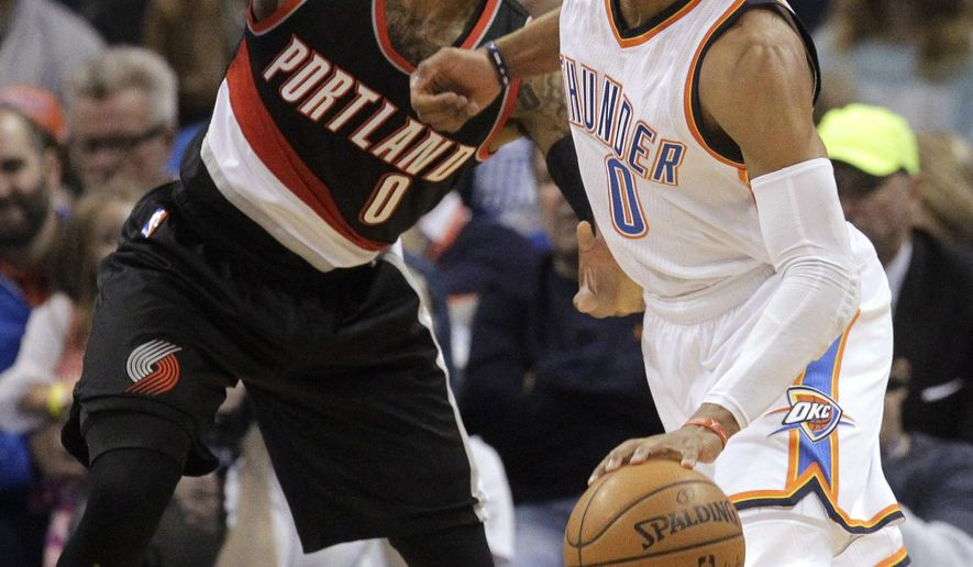 Oklahoma City Thunder guard Russell Westbrook, right, drives around Portland Trail Blazers guard Damian Lillard during the first half of an NBA basketball game in Oklahoma City, Wednesday, Dec. 16, 2015. (AP Photo/Sue Ogrocki)