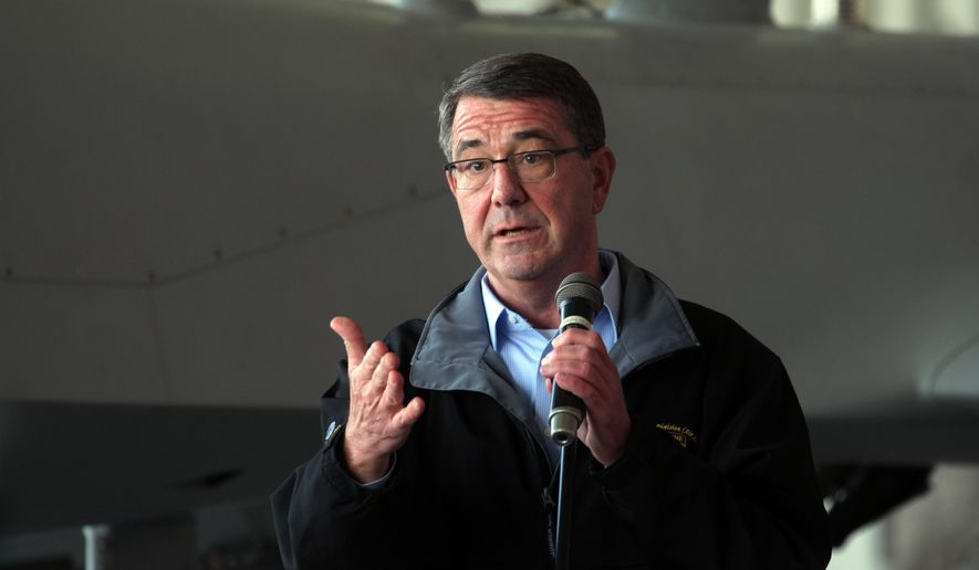 "U. S. Defense Secretary Ash Carter addresses the U.S. troops at the Incirlik Air Base near Adana, Turkey, Tuesday, Dec. 15, 2015. Carter said the U.S. wants Turkey to better control its border with Syria, which could help block the flow of foreign fighters to the Islamic State group, and to more forcefully join the U.S.-led coalition ""in the air and on the ground."" (AP Photo)"