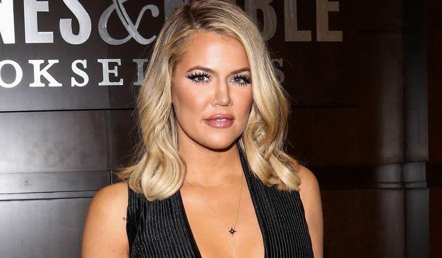 """FILE - In Monday, Nov. 9, 2015 file photo, Khloe Kardashian poses for a photo at the book-signing for her new book """"Strong Looks Better Naked,"""" at Barnes & Noble The Grove in Los Angeles. Kardashian is behind a new makeover series at the E! network, where she promises to help the brokenhearted get the """"ultimate payback."""" E! said Wednesday, Dec. 16, it had approved a six-episode series where Kardashian will be the mentor for people trying to turn their life around. (Photo by John Salangsang/Invision/AP, File)"""