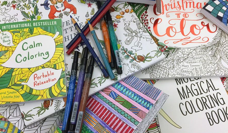 This Dec. 8, 2015 photo shows a display of adult coloring books and markers in New York. Coloring books for grown-ups were the hottest trend this year. (AP Photo/Beth J. Harpaz)