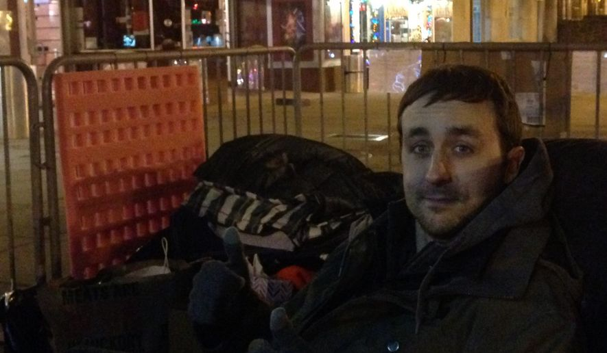 David Casterline, a 28-year-old photographer who camped in front of the Uptown Theater in Northwest since last Friday, hoped to be the first in line to see the film which opened at midnight Thursday. (Eric Althoff/THE WASHINGTON TIMES)