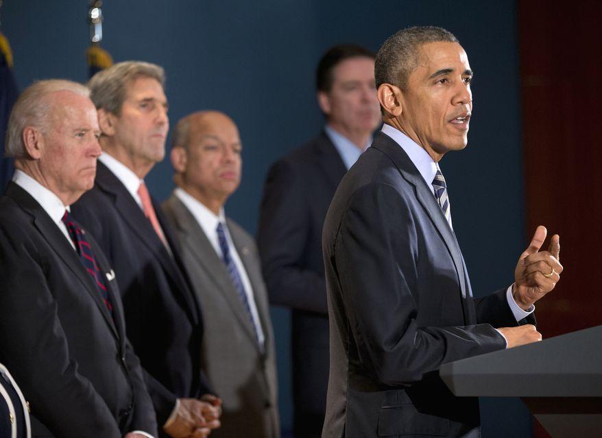 President Obama speaks at the National Counterterrorism Center in McLean, Va., on Dec. 17, 2015. Joining him are (from left) Vice President Joe Biden, Secretary of State John Kerry, Homeland Security Secretary Jeh Johnson, and FBI Director James Comey. (Associated Press) **FILE**