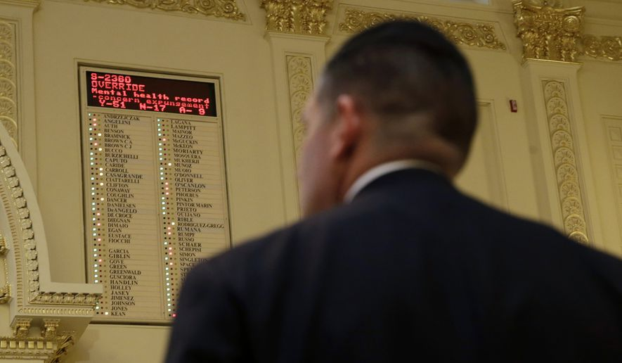 Assemblyman Louis D. Greenwald, D-Voorhees, N.J., watches the tally board as the Democrat-led Assembly vote fails to override Gov. Chris Christie on a bill he conditionally vetoed this year, Thursday, Dec. 17, 2015, in Trenton, N.J. The Assembly vote was suspended on Thursday, falling three votes short of the support needed to rebuke Christie. Their final opportunity to override the veto will be on Jan. 11. (AP Photo/Mel Evans)
