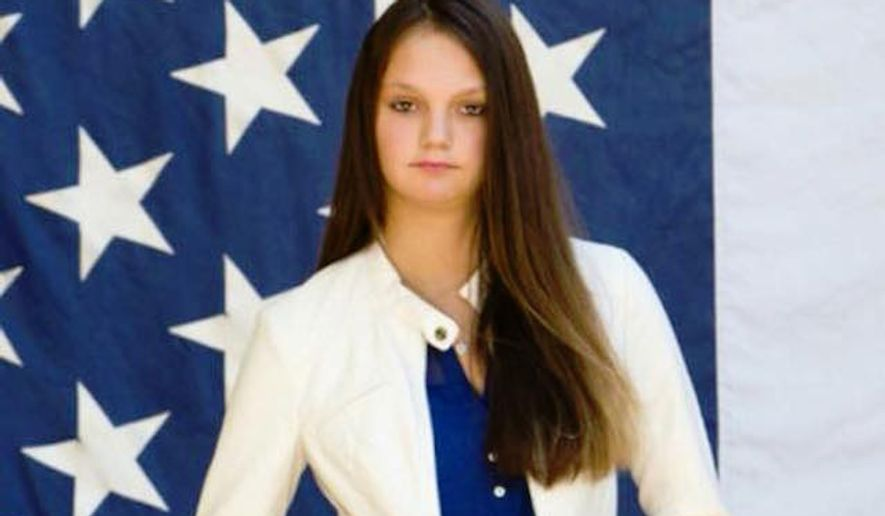 A photo of high school senior Morgan Truax standing on part of a backdrop of the American flag has been barred from the Foxborough High School yearbook after school officials deemed it inappropriate and disrespectful. (Facebook/@Lisa Truax)