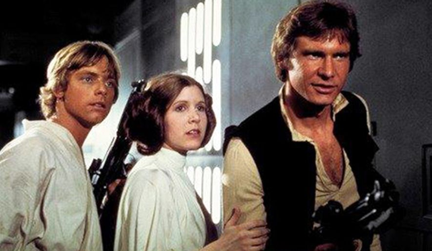 """This photo provided by Twentieth Century Fox Home Entertainment shows, Mark Hamill, from left, as Luke Skywalker, Carrie Fisher as Princess Leia Organa, and Harrison Ford as Hans Solo in the original 1977 """"Star Wars: Episode IV - A New Hope"""" film, included in the new Blu-ray release of  """"Star Wars: The Complete Saga"""" out on Oct. 13, 2015. The new film, """"Star Wars: The Force Awakens,"""" opens in U.S. theaters on Dec. 18, 2015. (Twentieth Century Fox Home Entertainment via AP)"""