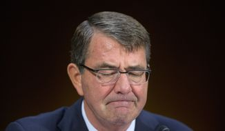 Defense Secretary Ashton Carter pauses as he testifies on Capitol Hill before the Senate Armed Service Committee on the Islamic State on Dec. 9, 2015. (Associated Press) **FILE**