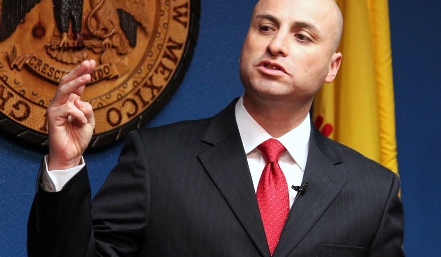 """FILE - In this Jan. 29, 2015, file photo, New Mexico Attorney General Hector Balderas talks during a news conference in Albuquerque, N.M. A letter written by Balderas says he's """"concerned"""" 15 percent of employees in the state's largest school district don't have background checks on file. In a letter to Albuquerque Public Schools on Wednesday, Dec. 16, Balderas said that district officials should work quickly to conduct background checks on 2,270 employees (AP Photo/Susan Montoya Bryan, File)"""