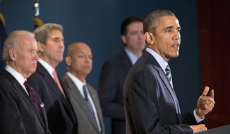 President Barack Obama speaks at the National Counterterrorism Center in McLean, Va., Thursday, Dec. 17, 2015. Joining him, from left are, Vice President Joe Biden, Secretary of State John Kerry, Homeland Security Secretary Jeh Johnson, and FBI Director James Comey. (AP Photo/Pablo Martinez Monsivais)