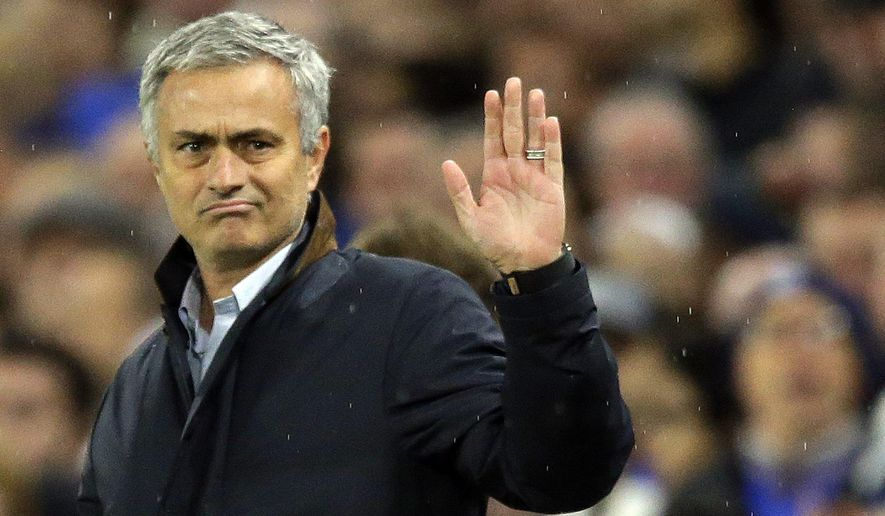 FILE - In this Wednesday, Nov. 4, 2015 file photo, Chelsea manager Jose Mourinho waves to fans singing in his support during the Champions League Group G soccer match between Chelsea and Dynamo Kiev at Stamford Bridge Stadium in London.  Mourinho has left Chelsea with the club languishing one point above the relegation zone just seven months after winning the Premier League title, it was reported on Thursday, Dec. 17, 2015. (AP Photo/Matt Dunham, File)