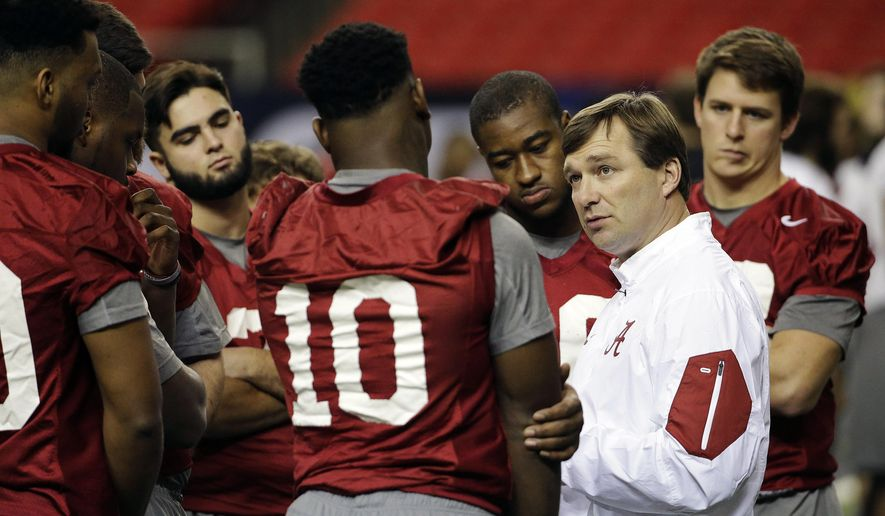 FILE - In this Friday, Dec. 4, 2015 file photo, Alabama defensive coordinator Kirby Smart talks to players during a team workout ahead of Saturday's Southeastern Conference championship NCAA college football game against Florida in Atlanta. Bronco Mendenhall and Kirby Smart are pulling double-duty this month after accepting head coaching positions with other programs. (AP Photo/David Goldman, File)