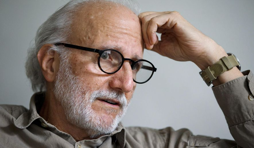 """In this photo taken Dec. 11, 2015, Alan Gross is interviews in his home in Washington. Alan Gross spent five years in a Cuban prison. Gross spent five years in a Cuban prison before being released last year as part of a historic reopening of relations between the United States and Cuba, but he says he'd travel back to the island nation """"in a heartbeat, as long as the government promises not to re-arrest me.""""(AP Photo/Jacquelyn Martin)"""