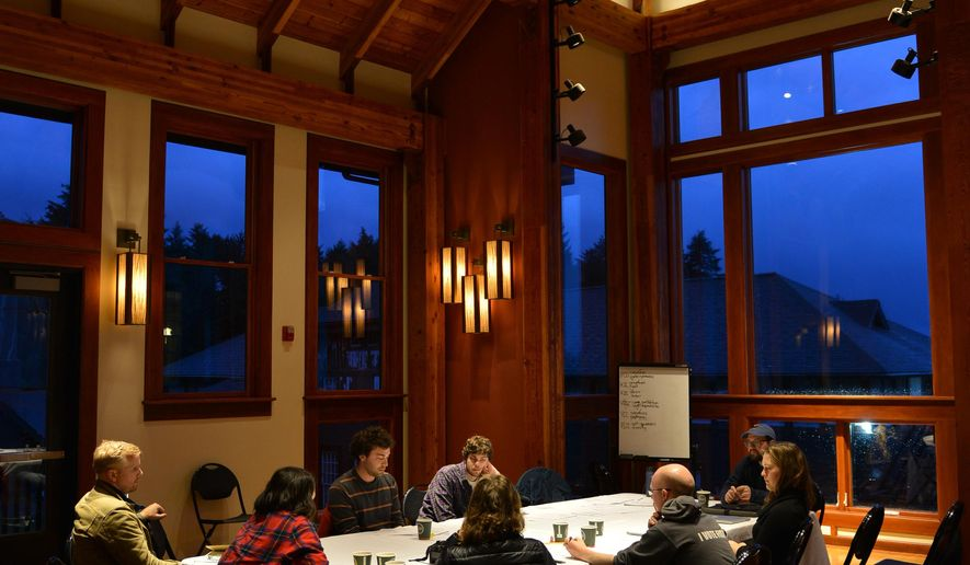 ADVANCE FOR WEEKEND EDITIONS, DEC. 19-20 - In this photo taken Nov. 12, 2015, a group works into the evening to discuss the framework of a new college based on northern California's student-run Deep Springs College model in Allen Hall on the Sheldon Jackson College campus in Sitka, Alaska. The proposed Outer Coast College would offer a two-year program on a different model than that of traditional higher education. Students would make decisions on nearly everything, from meals to classes to faculty. (James Poulson/Daily Sitka Sentinel via AP) MANDATORY CREDIT