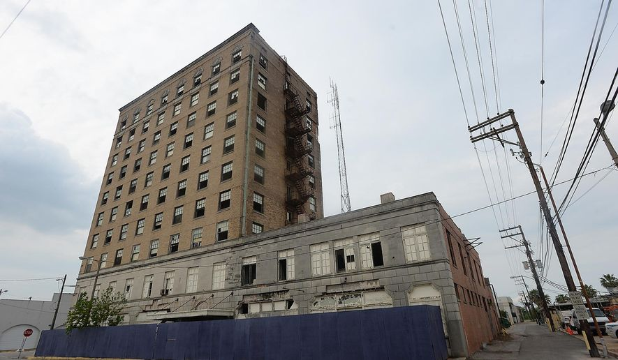 ADVANCE FOR SUNDAY, DEC. 20 AND THEREAFTER - In an April 15, 2015 photo, the old Hotel Sabine is among the Port Arthur abandoned and deteriorating commercial properties which the city hopes to demolish in revitalization efforts. It is being offered up as part of a film-friendly incentive proposal to potential film-makers. (Kim Brent/The Enterprise via AP)