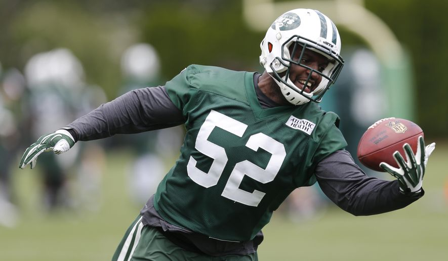 FILE - This June 9, 2015 file photo shows New York Jets inside linebacker David Harris making a catch during a mandatory minicamp at the NFL football team's facility in Florham Park, N.J. Never a self-promoter, Jets middle linebacker David Harris shuns spotlight while acting as 'glue' of defense. (AP Photo/Julio Cortez, file)