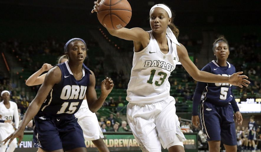 Baylor forward Nina Davis (13) reaches out to grab a loose ball in front of Oral Roberts' Faith Ihim (15) as Bria Pitts (5) watches during the second half of an NCAA college basketball game, Thursday, Dec. 17, 2015, in Waco, Texas. Baylor won 97-39. (AP Photo/Tony Gutierrez)