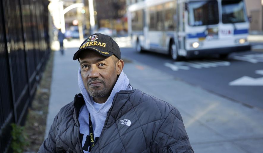 U.S. paralyzed Army veteran Gene Laureano sits in his wheelchair Wednesday, Dec. 16, 2015, in Bronx, N.Y. The Department of Veterans Affairs has agreed to pay for robotic legs that could allow scores of paralyzed veterans, like Laureano, with spinal cord injuries to walk again. (AP Photo/Mel Evans)
