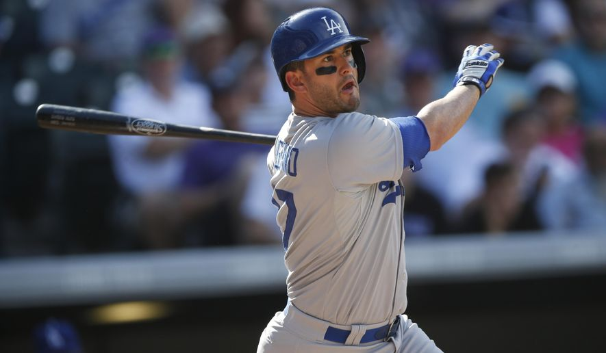 FILE - In this Sept. 27, 2015, file photo, Los Angeles Dodgers center fielder Justin Ruggiano (27) bats in the fourth inning of a baseball game, in Denver. Free-agent outfielder Justin Ruggiano has agreed to a $1.65 million, one-year contract with Texas, giving the Rangers a-needed right-handed bat. Only $500,000 of his salary is guaranteed under Thursday's, Dec. 17, 2015,  deal.(AP Photo/David Zalubowski, File)