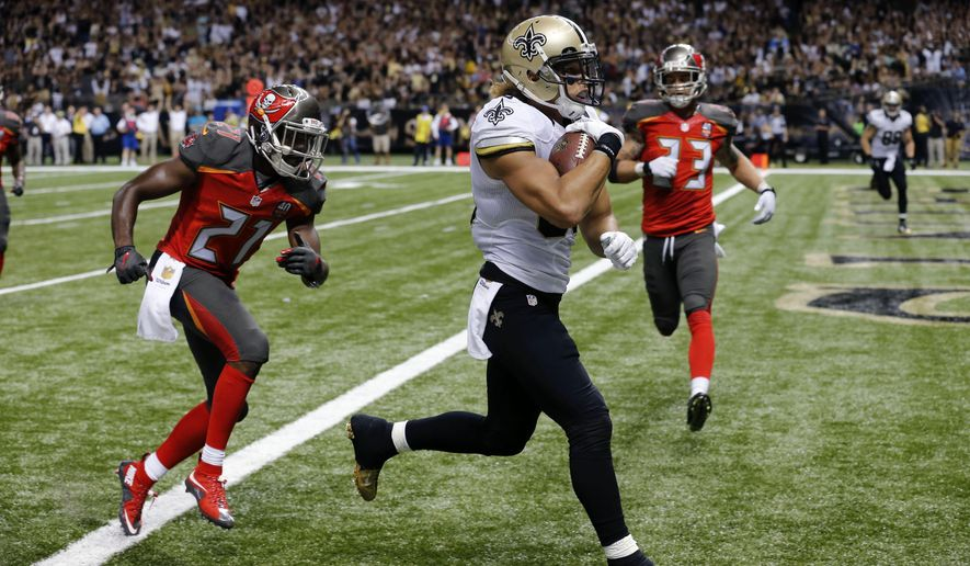 FILE - In this Sept. 20, 2015, file photo, New Orleans Saints wide receiver Willie Snead scores on a touchdown reception in front of Tampa Bay Buccaneers cornerback Alterraun Verner (21) during an NFL football game in New Orleans. Saints coach Sean Payton sees several similarities between one of his favorite former New Orleans receivers, Lance Moore, and Snead, who has burst onto the scene with the Saints this year. Both pass-catchers play in the Superdome on Monday night when the Detroit Lions pay a visit. (AP Photo/Bill Haber, File)