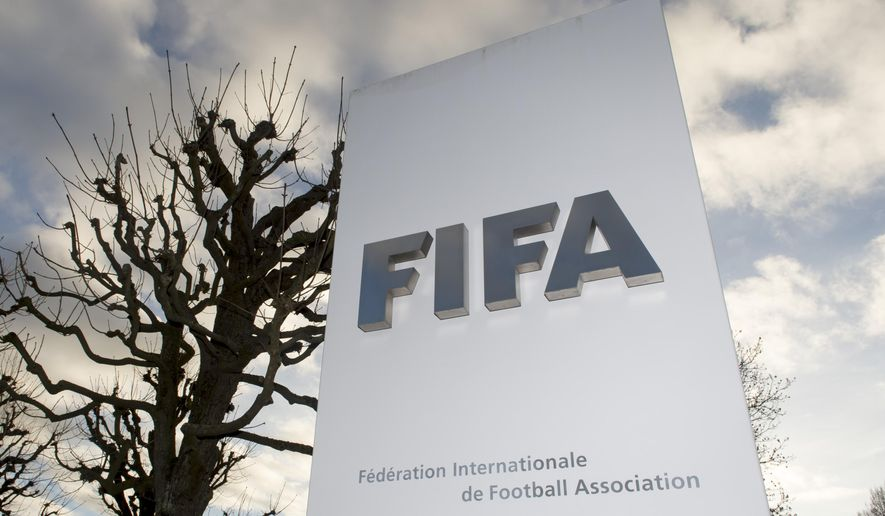 The FIFA logo is pictured outside the FIFA headquarters in Zurich, Switzerland, Thursday, Dec. 17, 2015. While FIFA President Sepp Blatter will appear in person on Thursday before the panel of four judges of the FIFA ethics court, UEFA President Michel Platini plans to boycott his hearing on Friday Dec. 18. Blatter and Platini were banned for 90 days for all activities in football. (Walter Bieri/Keystone via AP)