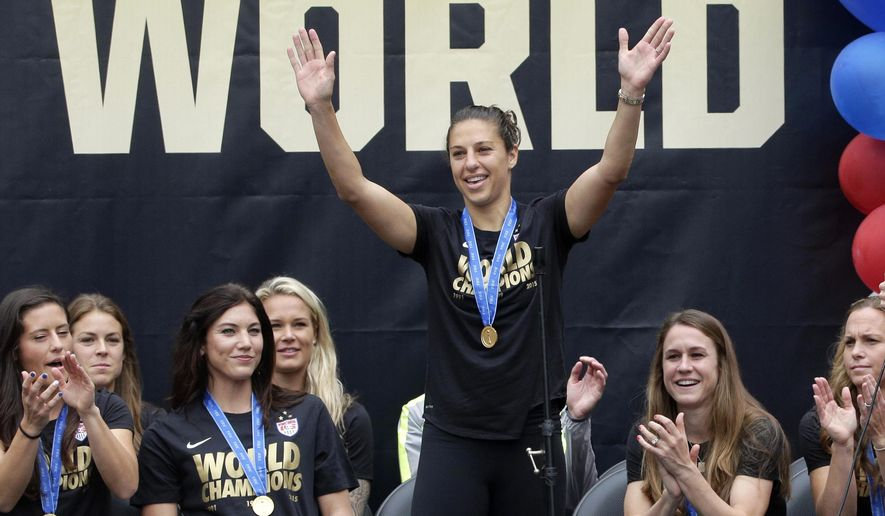 FILE - In this July 7, 2015, file photo, U.S. women's soccer team midfielder Carli Lloyd acknowledges cheers during a public rally held to celebrate the team's World Cup championship, in Los Angeles. Midfielder Carli Lloyd has been voted the U.S. Soccer Federation's Female Player of the Year after her hat trick in the final led the U.S. to its third Women's World Cup title. The announcement was made Wednesday, Dec. 16, 2015. (AP Photo/Jae C. Hong, File)