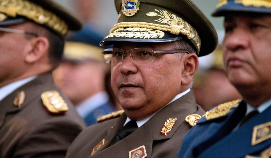 Venezuela's National Guard Commander Gen. Nestor Reverol attends a ceremony commemorating the anniversary of the death of independence hero Simon Bolivar in Caracas, Venezuela, Thursday, Dec. 17, 2015. Reverol is named in an indictment in federal court in New York City that accuses him of tipping off traffickers to raids and hindering investigations when he served as Venezuela's drug czar, the officials said. The officials spoke on condition of anonymity because the indictment remains under seal. (AP Photo/Fernando Llano)