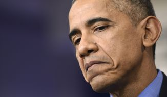 President Barack Obama pauses as he speaks during a news conference in the Brady Press Briefing room at the White House in Washington, Friday, Dec. 18, 2015. (AP Photo/Susan Walsh)