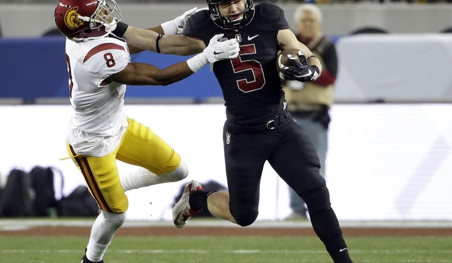 FILE - In this Dec. 5, 2015, file photo, Stanford running back Christian McCaffrey (5) tries to get past Southern California's Iman Marshall (8) during the Pac-12 Conference championship NCAA college football game against, in Santa Clara, Calif. McCaffrey was named to the Pac-12 All-Conference team Thursday, Dec. 17, 2015. (AP Photo/Marcio Jose Sanchez, File)