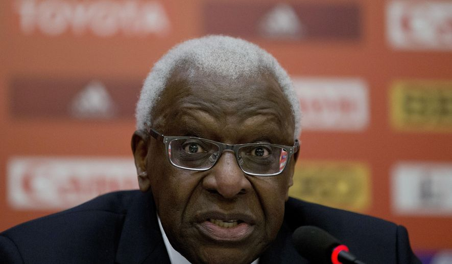 FILE - In this Thursday, Aug. 20, 2015 file photo,  then President of the International Association of Athletics Federations Lamine Diack speaks during the press conference at the IAAF Congress at the National Convention Center in Beijing. Newspaper Le Monde says former IAAF President Lamine Diack told French police he asked for 1.5 million euros ($1.6 million) from Russia to help finance the political opposition in his native Senegal. The request came at a time when the IAAF was dealing with a slew of Russian doping cases. (AP Photo/Andy Wong, File)