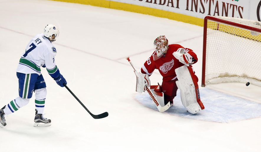 Vancouver Canucks right wing Linden Vey (7) scores the winning shootout goal on Detroit Red Wings goalie Jimmy Howard (35) during an NHL hockey game Friday, Dec. 18, 2015 in Detroit. Vancouver won 4-3 in a shootout (AP Photo/Paul Sancya)