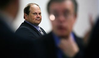FILE - In this July 15, 2015 file photo, Eddie Tipton looks over at his lawyers before the start of his trial in Des Moines, Iowa. The former security director of the Multi-State Lottery Association, accused of tampering with lottery drawings to rig jackpots in four states, was convicted of fraud in the attempt to claim a $16.5 million jackpot in Iowa. Investigators are now looking at payouts in 37 other states and U.S. territories that used random-number generators from the Iowa-based association, which administers games and distributes prizes for the lottery consortium. (Brian Powers/The Des Moines Register, File) MANDATORY CREDIT