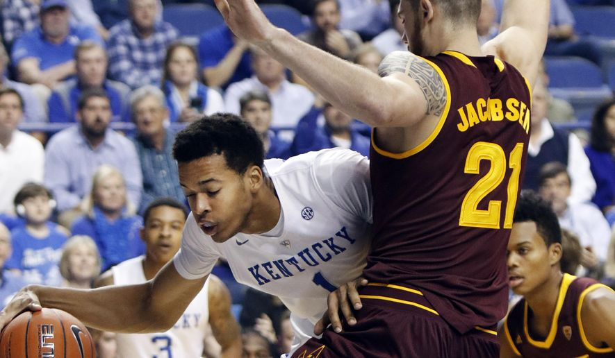 FILE - In this Dec. 12, 2015, file photo, Kentucky's Skal Labissiere, left, looks for an opening on Arizona State's Eric Jacobsen (21) during the first half of an NCAA college basketball game, in Lexington, Ky. Since a promising start Kentucky freshman forward Skal Labissiere has slumped to 18 points and seven rebounds combined in the past four games. That has sparked debate about what's wrong with the 6-foot-11 Haitian, but coach John Calipari and former Wildcat Kenny Walker believe it's nothing that time can't correct.  (AP Photo/James Crisp)