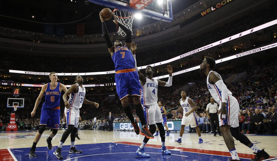 New York Knicks' Carmelo Anthony (7) goes up to shoot during the first half of an NBA basketball game against the Philadelphia 76ers, Friday, Dec. 18, 2015, in Philadelphia. (AP Photo/Matt Slocum)