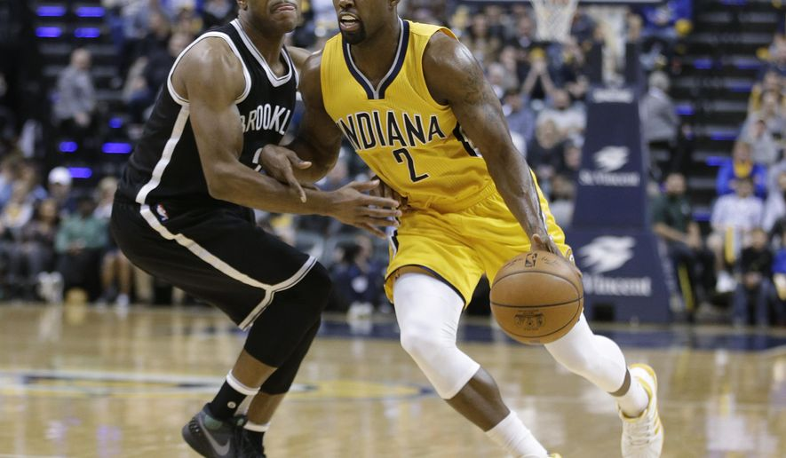Indiana Pacers' Rodney Stuckey (2) goes to the basket against Brooklyn Nets' Jarrett Jack (2) during the second half of an NBA basketball game Friday, Dec. 18, 2015, in Indianapolis. Indiana won 104-97. (AP Photo/Darron Cummings)