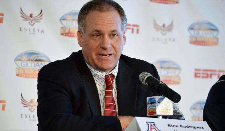 Arizona head coach Rich Rodriguez speaks during an NCAA college football news conference Friday, Dec. 18, 2015, in Isleta Pueblo, N.M. Arizona plays New Mexico in the New Mexico Bowl  on Saturday. (AP Photo/Russell Contreras)