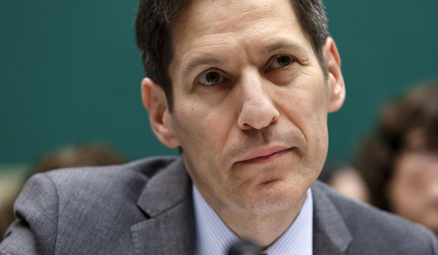 FILE - In this Oct. 16, 2014 file photo, Centers for Disease Control and Prevention (CDC) Director Dr. Tom Frieden, listens as he testifies on Capitol Hill in Washington. A bold federal effort to curb prescribing of painkillers may be faltering, amid stiff resistance from drugmakers, industry-funded groups and the government's own top drug regulator.  The agency has abandoned the January 2016  target date and opened the recommendations to public comment for 30 days.   (AP Photo/J. Scott Applewhite)