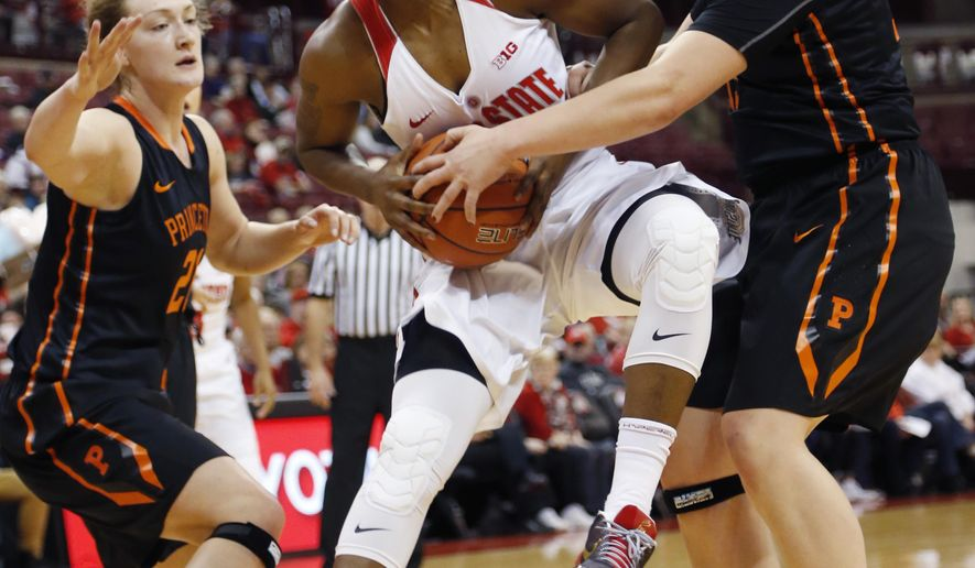 Ohio State's Shayla Cooper, center, drives to the basket against Princeton's Alex Wheatley, left, and Annie Tarakchian during the first half of an NCAA college basketball game Friday, Dec. 18, 2015, in Columbus, Ohio. (AP Photo/Jay LaPrete)