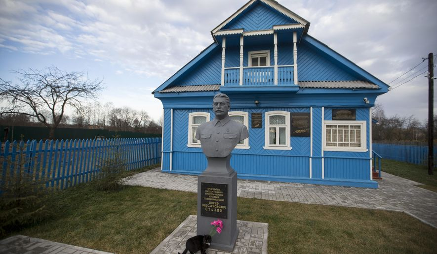 "In this Wednesday, Dec. 9, 2015 photo, a bust of Soviet leader Josef Stalin stands on the front lawn of a house-turned-museum in the village of Khoroshevo, west of Moscow, Russia. The Stalin museum was opened this year in this small village where the Soviet leader is said to have stayed the night on his only visit to the front during World War II. The sign on the monument reads ""Chairman of the State Defense Committee, Supreme Commander in Chief Josef Stalin."" (AP Photo/Pavel Golovkin)"