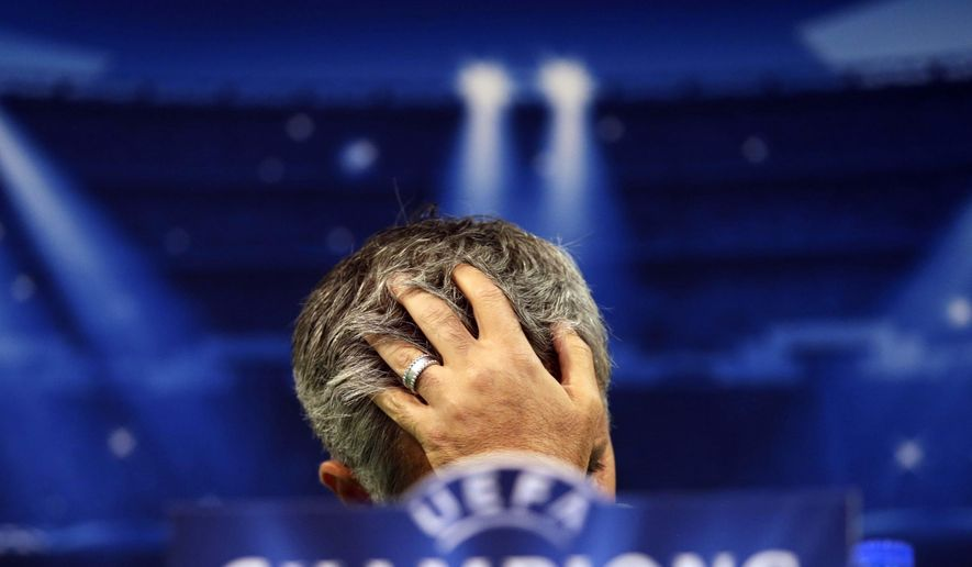 FILE - In this Monday, Sept. 29, 2014 file photo, Chelsea's coach Jose Mourinho, from Portugal, gestures, during a news conference at Sporting's Alvalade stadium, in Lisbon, Portugal. Mourinho has left Chelsea with the club languishing one point above the relegation zone just seven months after winning the Premier League title, it was reported on Thursday, Dec. 17, 2015.  (AP Photo/Francisco Seco, File)