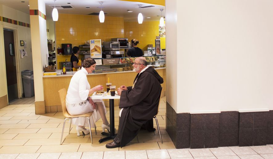 "Bonta and Fred Cunningham, dressed as Princess Leia and Obi-Wan Kenobi, grab something to eat at the MacArthur Center food court in Norfolk, Va., before seeing the showing of ""Star Wars: The Force Awakens"" on Thursday, Dec. 17, 2015. (L. Todd Spencer/The Virginian-Pilot via AP)  MAGS OUT; MANDATORY CREDIT"
