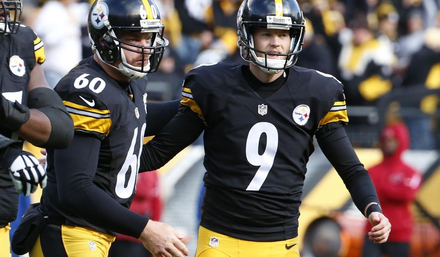FILE - In this Oct. 18, 2015, file photo, Pittsburgh Steelers kicker Chris Boswell (9) celebrates making a field goal with snapper Greg Warren in the second half of an NFL football game against the Arizona Cardinals in Pittsburgh. Chris Boswell began the season looking for a job. He will end it as the most productive rookie kicker in Pittsburgh Steelers history. Boswell is 24 of 26 since being signed in late September.  (AP Photo/Gene J. Puskar, File)
