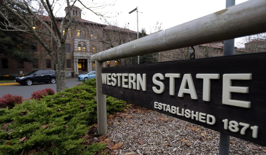 FILE - In this photo taken Nov. 18, 2015, a sign near the main entrance of Western State Hospital, the largest psychiatric hospital in the state, is shown in Lakewood, Wash. Gov. Jay Inslee's new budget proposal includes more than $137 million for the state's beleaguered mental health system at a time when Western State is under threat of losing federal funding because of safety concerns. (AP Photo/Ted S. Warren, File)