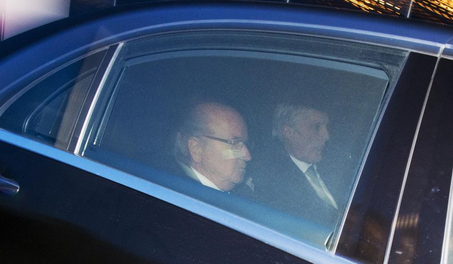 FIFA President  Sepp . Blatter , left,  and his lawyer Lorenz Erni, leave the FIFA headquarters 'Home of FIFA' in Zurich, Switzerland, Thursday, Dec. 17, 2015. While FIFA President Joseph S. Blatter  appeared in person on Thursday before the panel of four judges of the FIFA ethics court, UEFA President Michel Platini plans to boycott his hearing on Friday  dec. 18. Blatter and Platini were banned for 90 days for all activities in football.  (Walter Bieri/Keystone via AP)