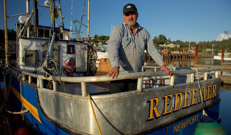 "This photo provided by courtesy of  Discovery shows Captain Gary Ripka standing on his boat, the FV Redeemer, at the dock in Newport, Ore., the setting of ""Deadliest Catch: Dungeon Cove,"" airing in the fall of 2016 on Discovery.  (Discovery via AP)"