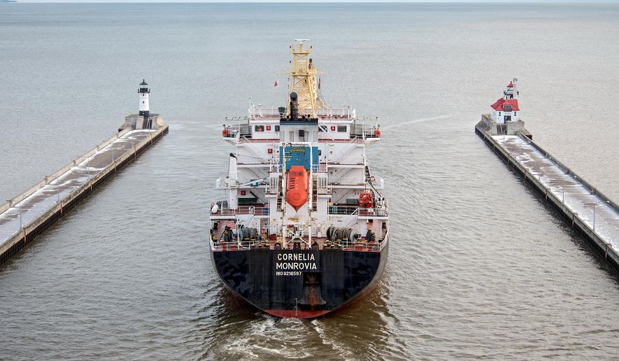 The German-operated cargo ship M/V Cornelia sails out of the Lake Superior port of Duluth, Minnesota, in this photo taken Friday, Dec. 18, 2015. The Liberian-flagged Cornelia and its crew of 19 had been detained by the U.S. Coast Guard for six weeks over alleged environmental violations until an agreement was reached to let the oceangoing ship depart. (Robert Welton/Seaway Port Authority of Duluth via AP)