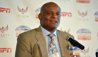 Former Houston Oilers quarterback Warren Moon speaks at a New Mexico Bowl NCAA college football news conference Friday, Dec. 18, 2015, in Isleta Pueblo, N.M. Moon said he is honored to have helped open the door for future black quarterbacks in the NFL and enjoys watching the Carolina Panthers' Cam Newton and the Seattle Seahawks' Russell Wilson. (AP Photo/Russell Contreras)